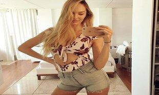 Candice Swanepoel, espectacular en shorts y luciendo escotazo un mes...