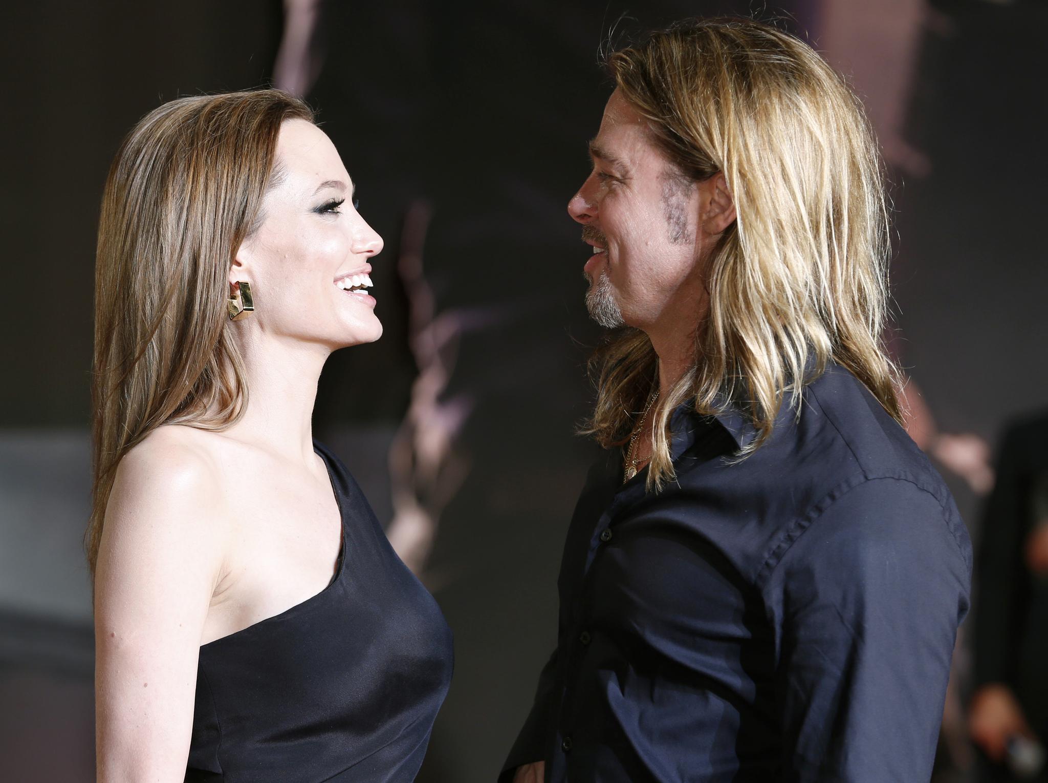 """La pareja juntos y felices en la premiere de """"Guerra Mundial Z"""", en..."""