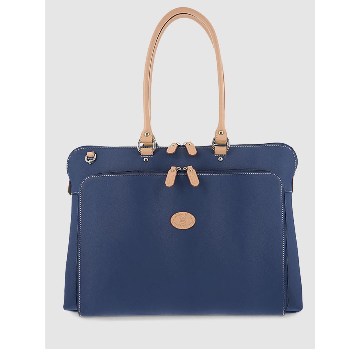 7. Portadocumentos de canvas en azul con bolsillo exterior, de El Corte Inglés (104,30 euros)