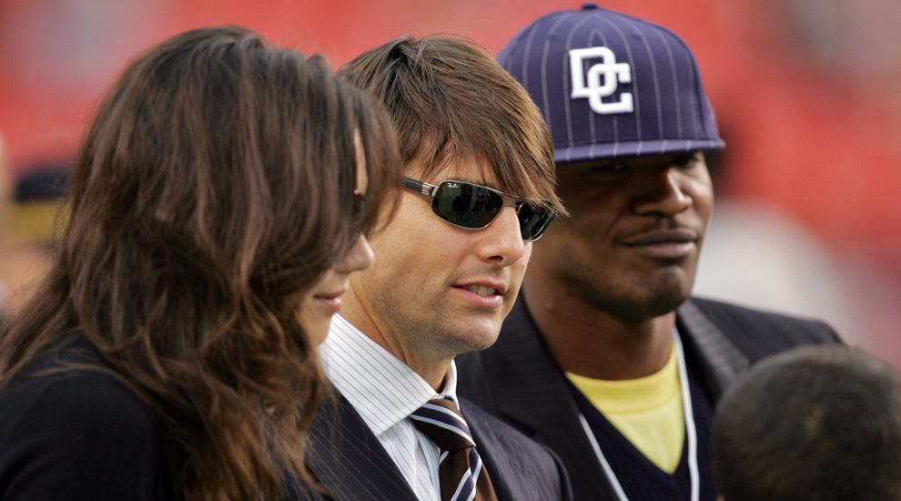 Katie Holmes, Tom Cruise y Jamie Foxx coincidieron durante un partido...