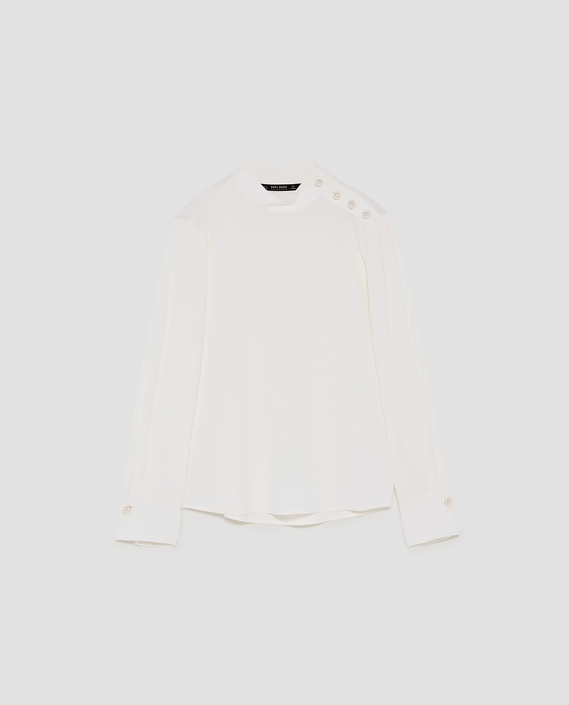 Blusa de Zara (29,99 euros).