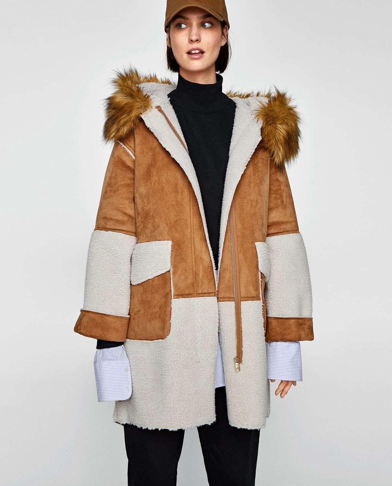 Abrigo de doble material con borrego, de Zara (de 69,95 a 39,95...