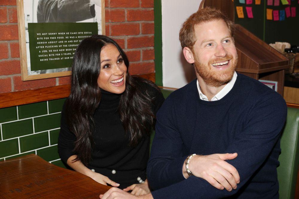Meghan Markle y el príncipe Harry durante su visita a Escocia.