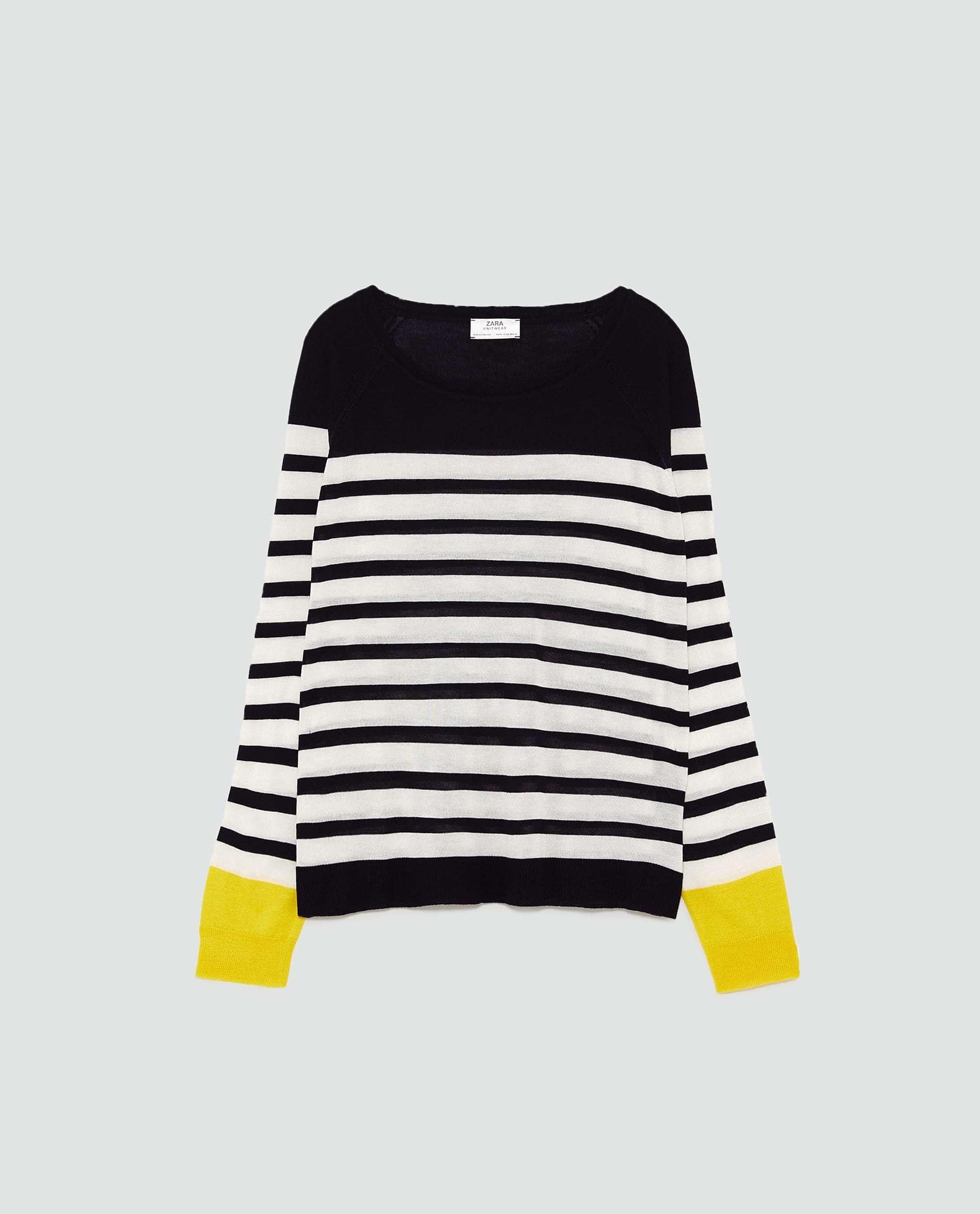 Jersey de rayas con puños amarillos de Zara (12,95 euros)
