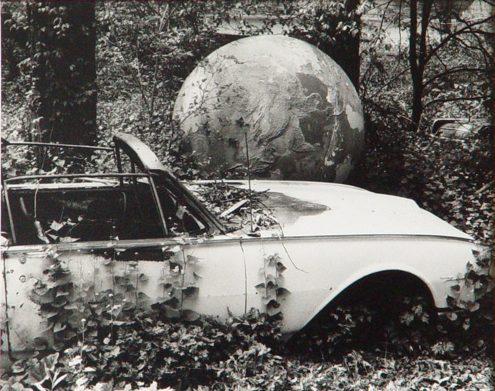 Abandoned car with globe. Date 1988 89. Marion Scemama Collection....