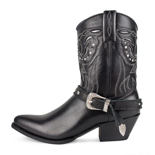 Botas estilo <em>cowboy</em> (349 euros), de Sendra.