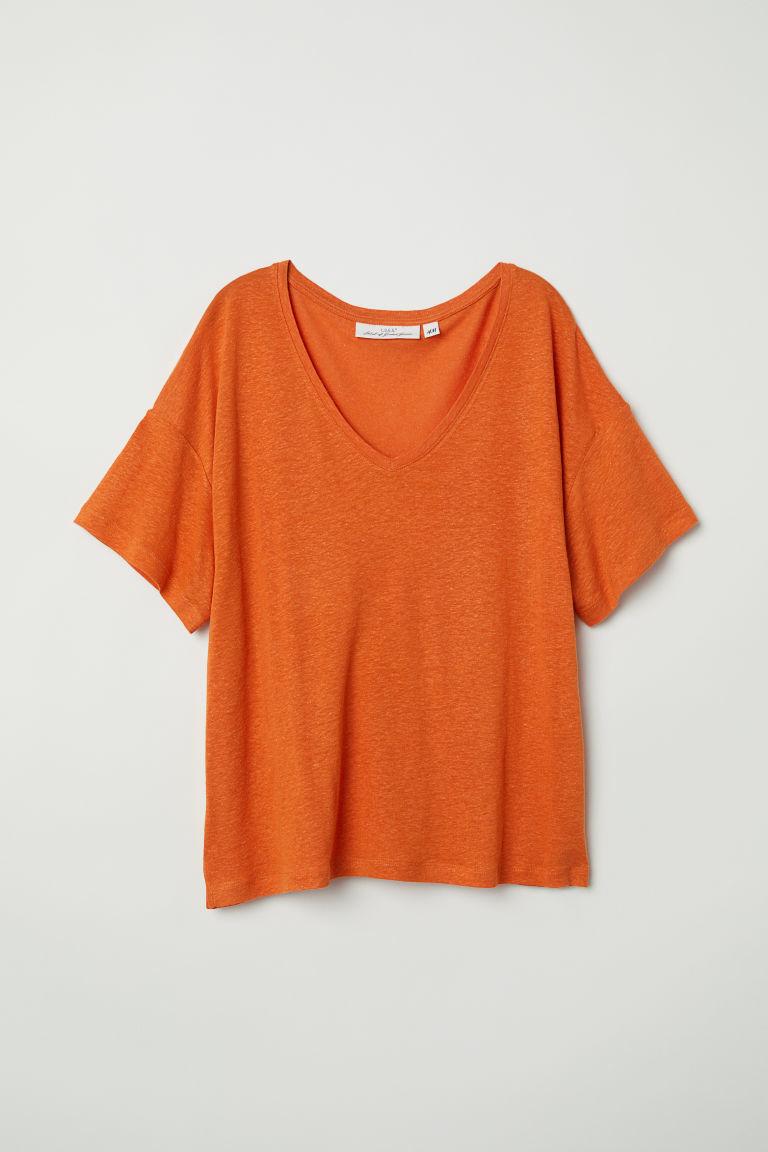 Camiseta básica de manga corta en naranja, de H&M (6,49 euros).