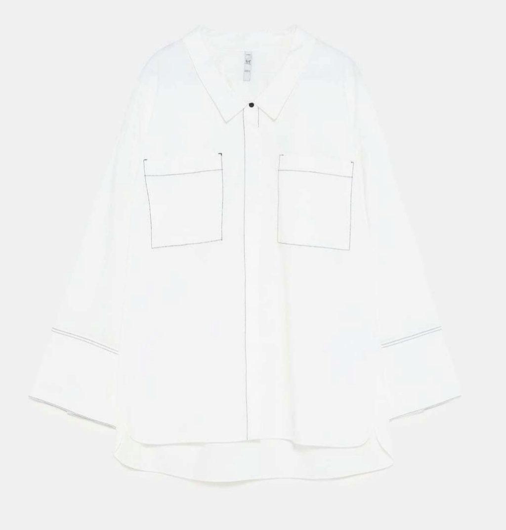 Camisa blanca con mangas acampanadas, de Zara (22,95 euros).
