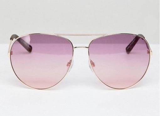 Gafas con cristales rosados, de River Island (8,49 euros).