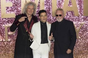 Singer Brian May, Rami Malek and Roger Taylor at the World premiere of...