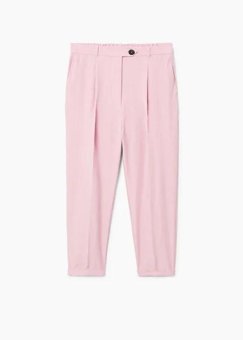 Pantalón de pinza estilo recto en rosa claro, de Mango (29,99 euros).