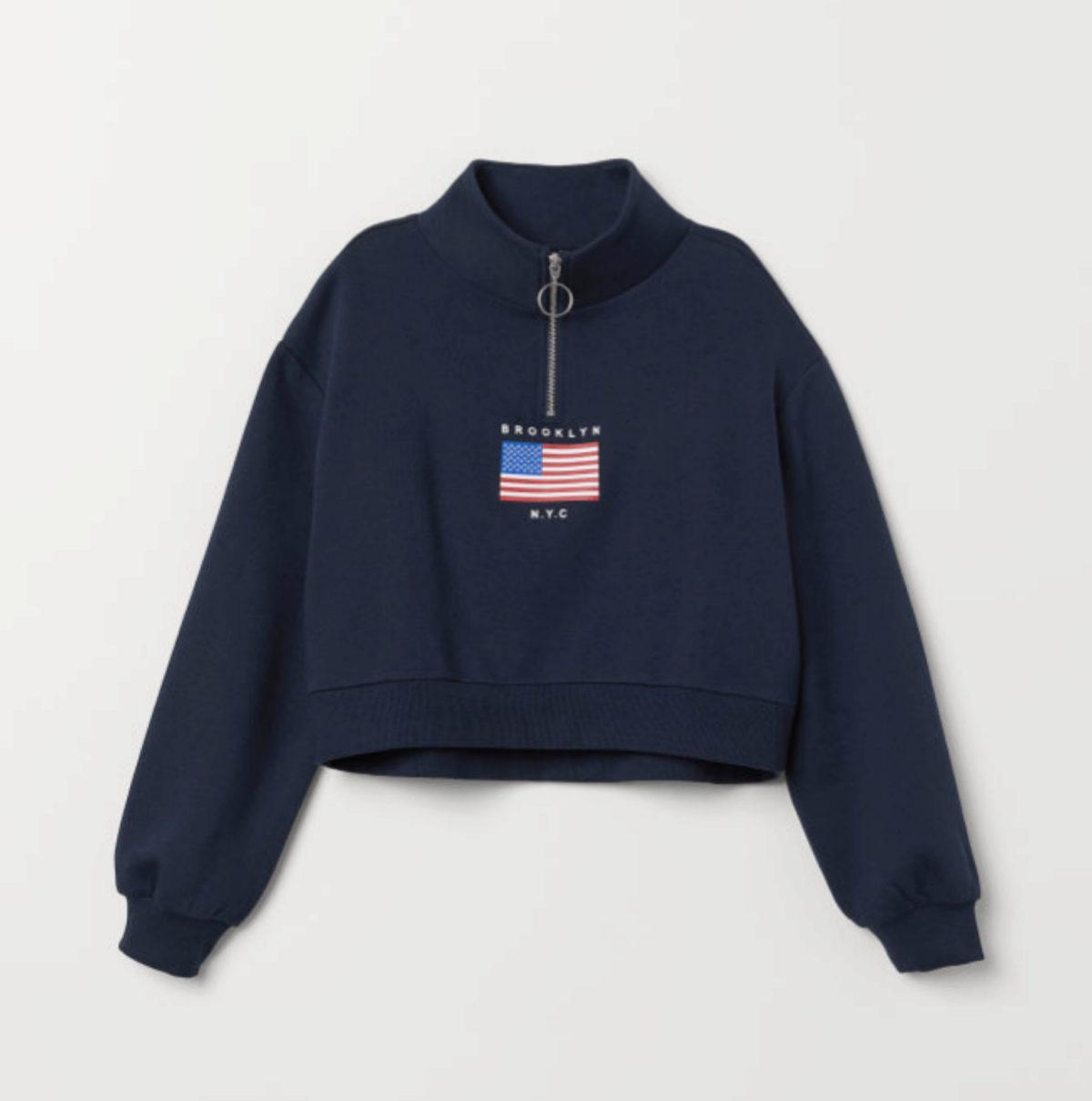 Sudadera azul marina con letras y bandera de Estados Unidos, de H&M...