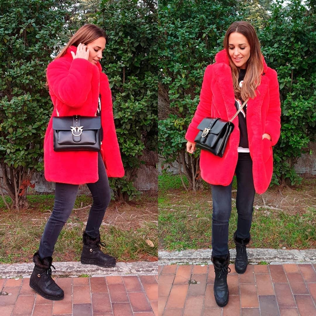 Paula Echevarría con botas y abrigo para combatir el frío.