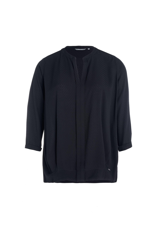 Blusa negra, de Salsa (39,90 euros).