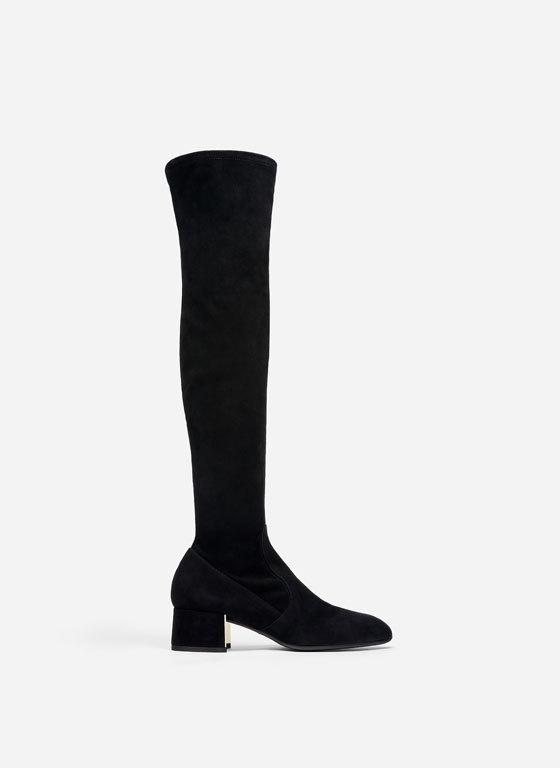 Botas de ante negro con tacón de Uterqüe. (179,00 euros).