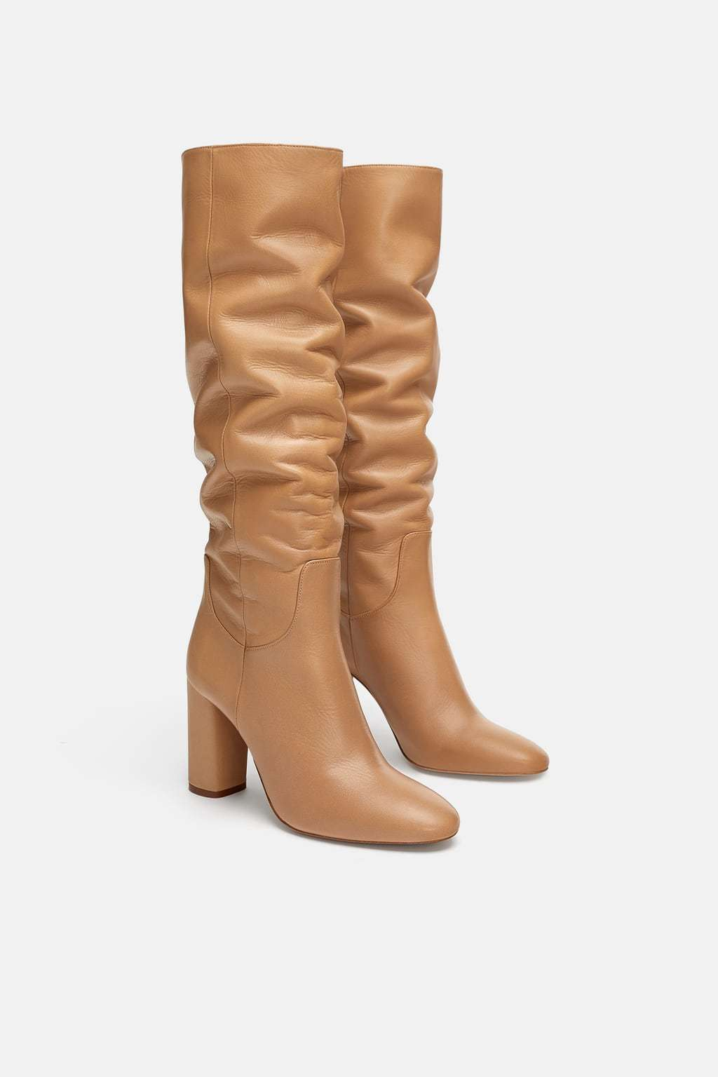 Botas altas de Zara (99,95 euros).