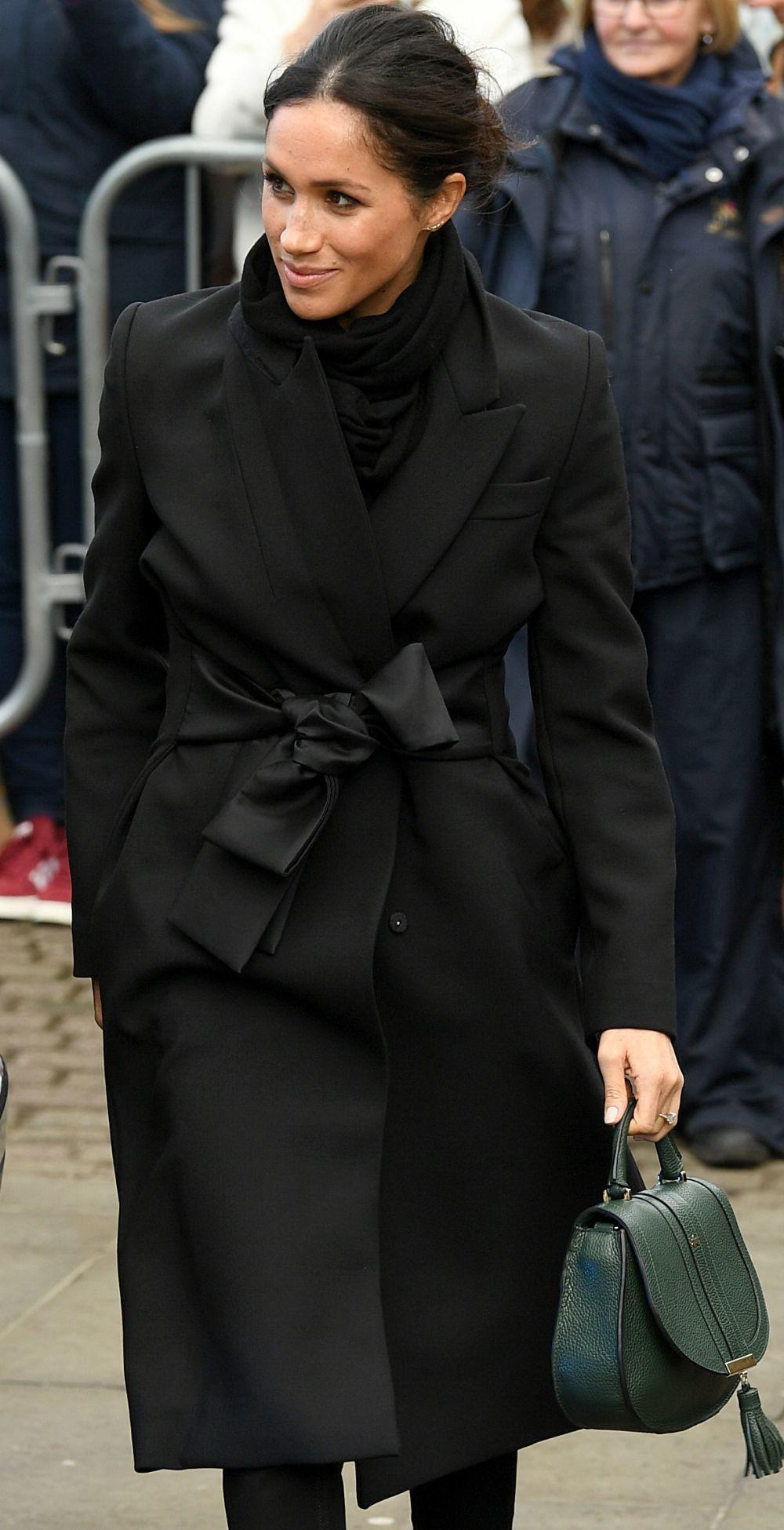 Meghan Markle con un bolso de DeMellier.