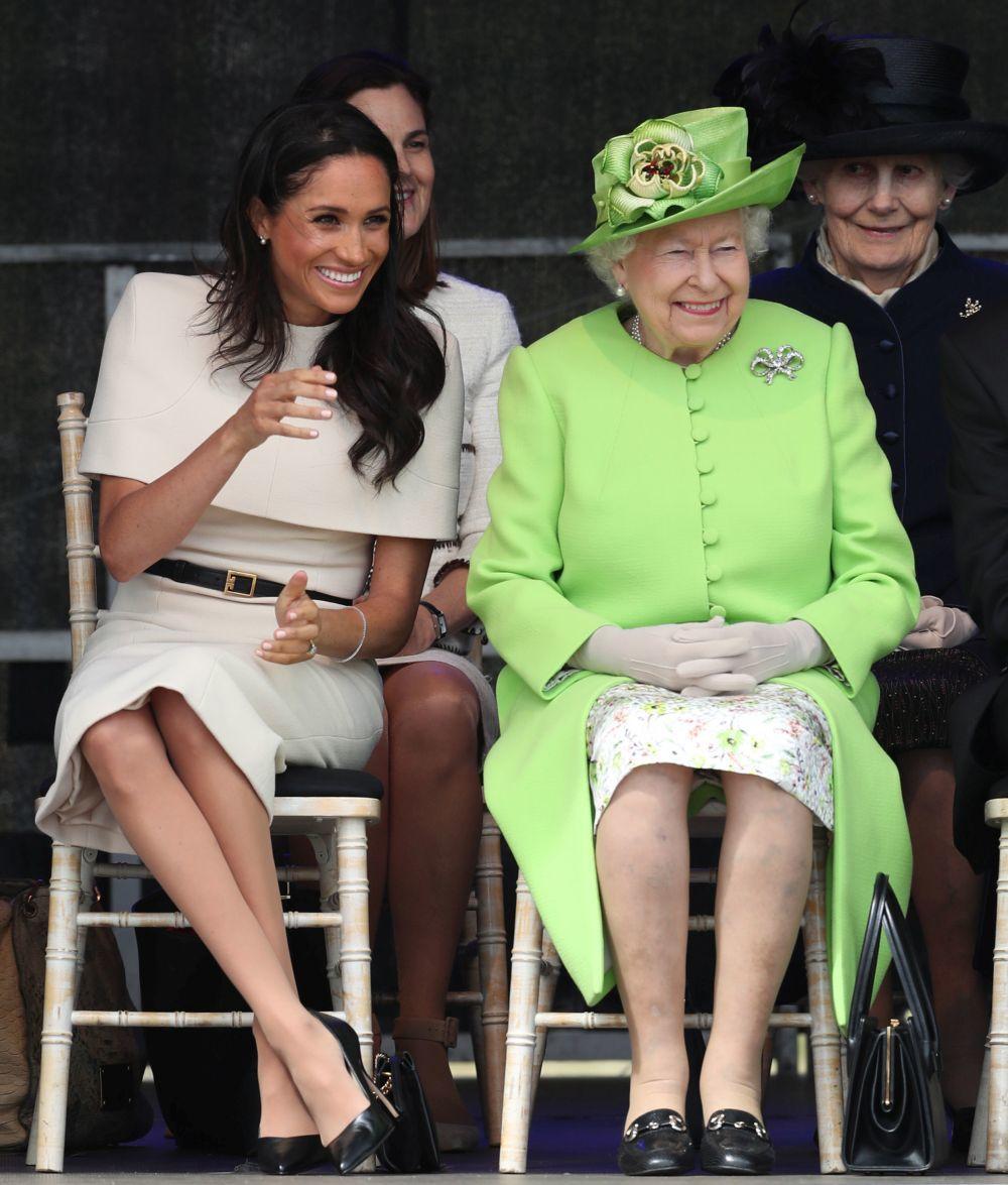 Meghan Markle en un acto oficial junto a Isabel II.