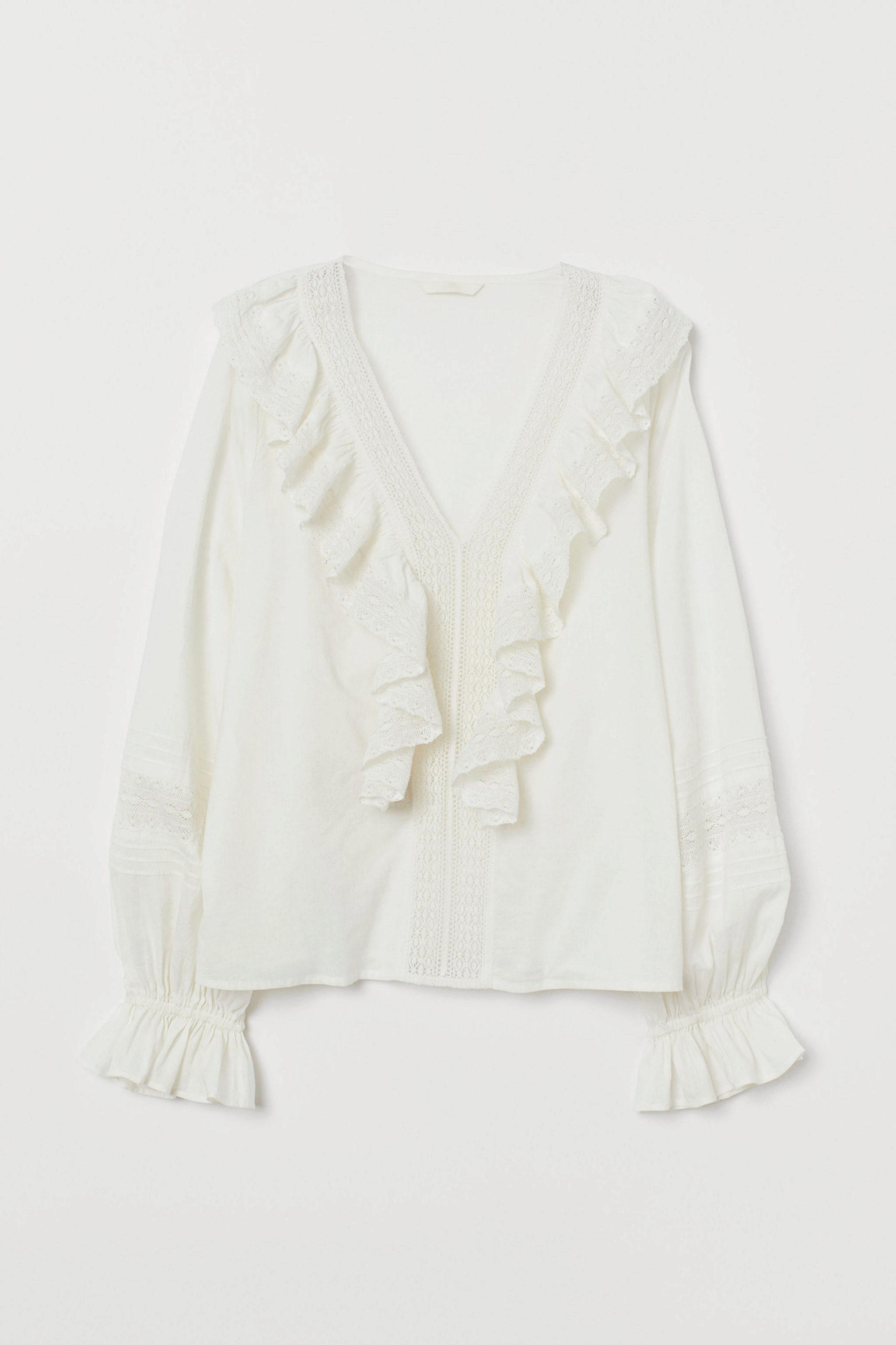 Blusa romántica con encaje de H&M