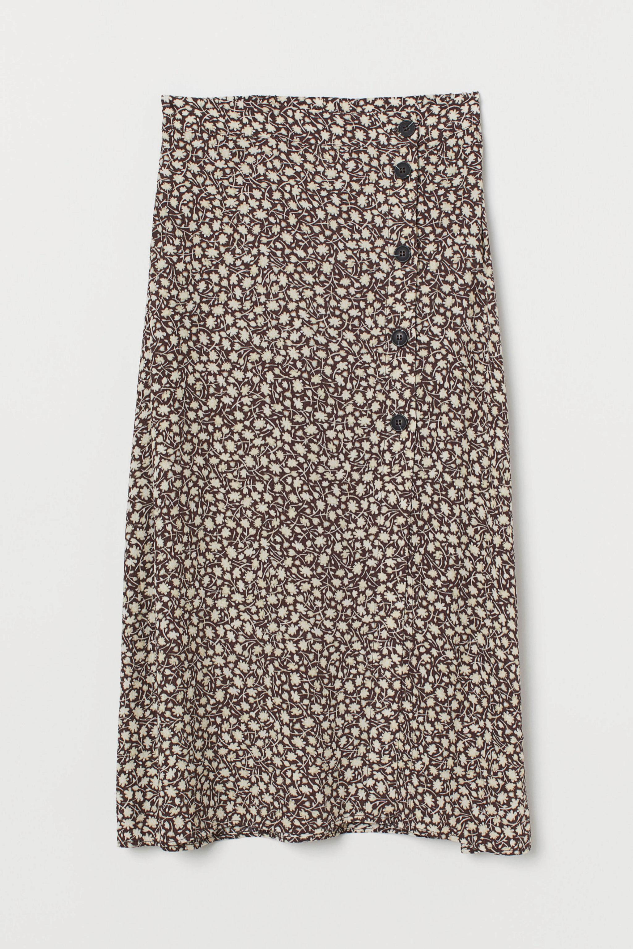 Falda midi con estampado de flores y vuelo de H&M