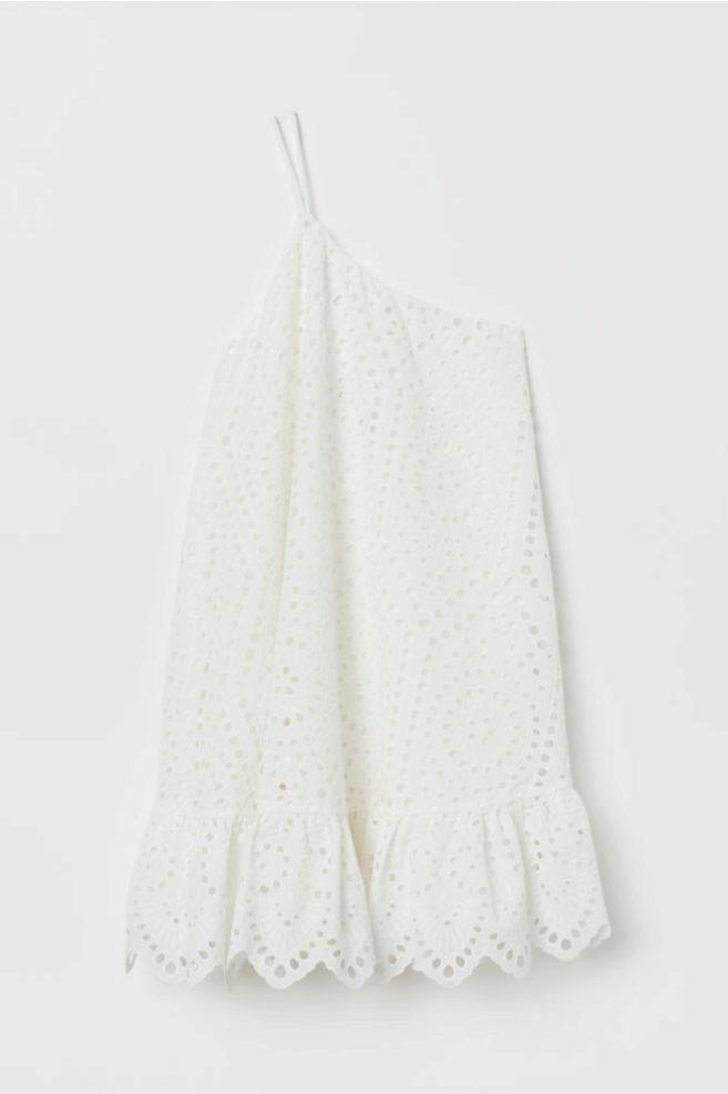 Vestido asimétrico calado en blanco de H&M