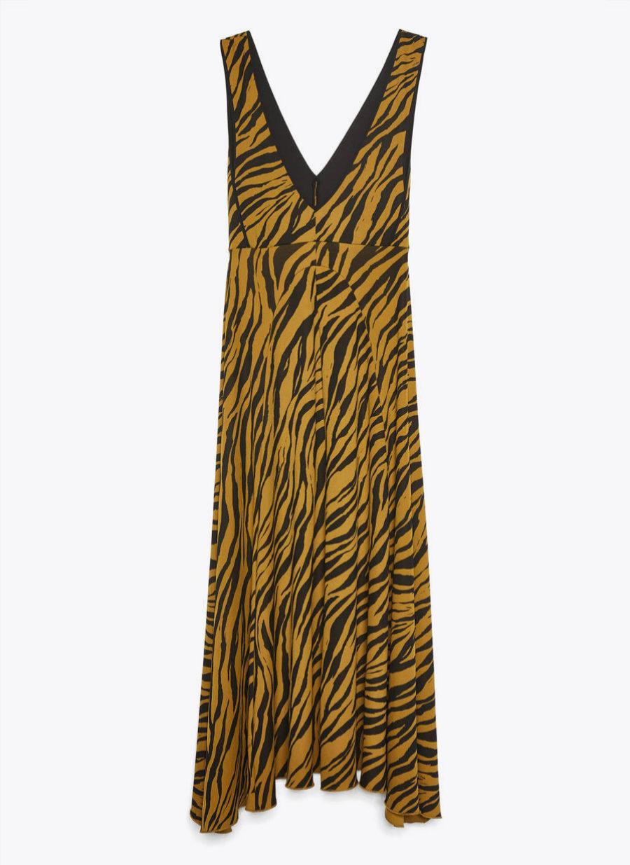 Vestido de estampado animal con escote en V de Uterqüe