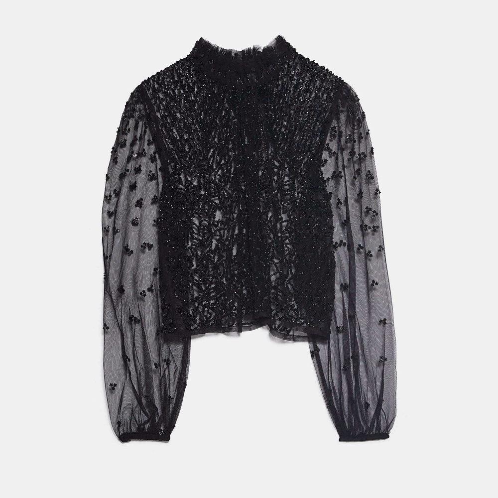 Blusa de transparencias, de Zara (39,95 euros).