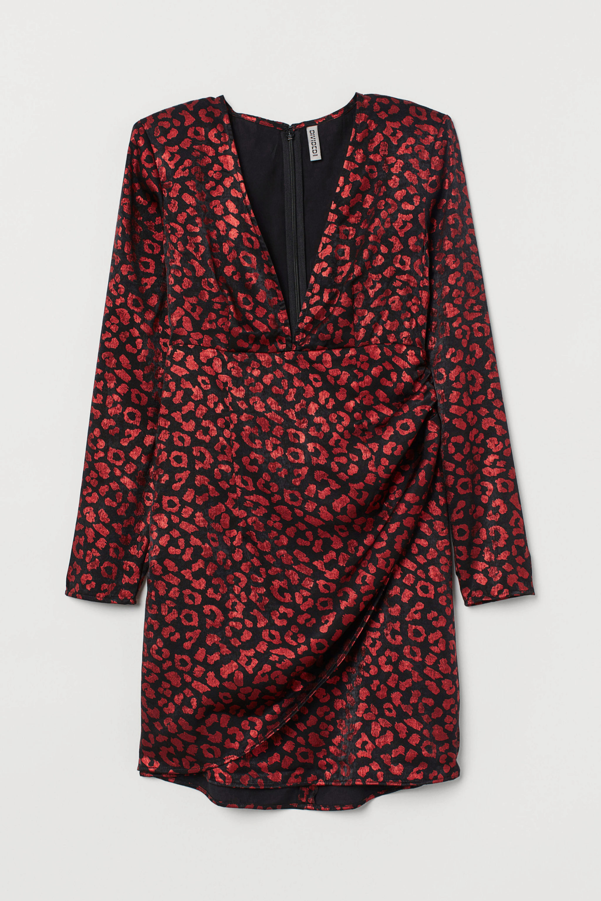 Mini vestido estampado con hombreras de H&M (24,99¤)