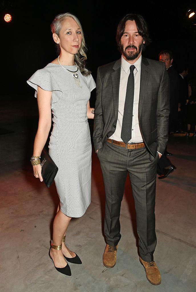 Alexandra Grant y and Keanu Reeves en la UNAIDS Gala de Art Basel, en junio de 2016.