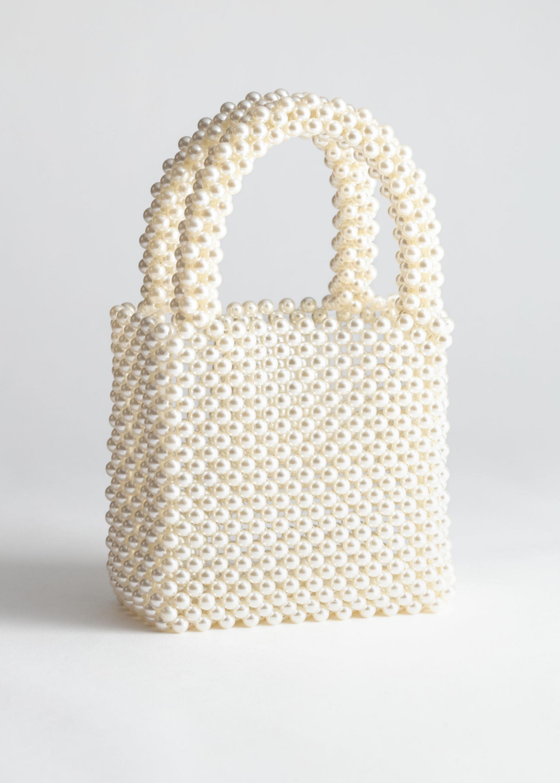 Mini bolso con asa corta de perlas de & Other Stories (59¤)