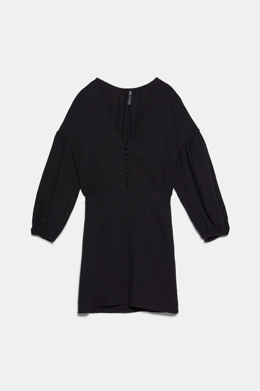 Vestido de tejido rústico y volúmenes en las mangas de Zara (9,99¤)