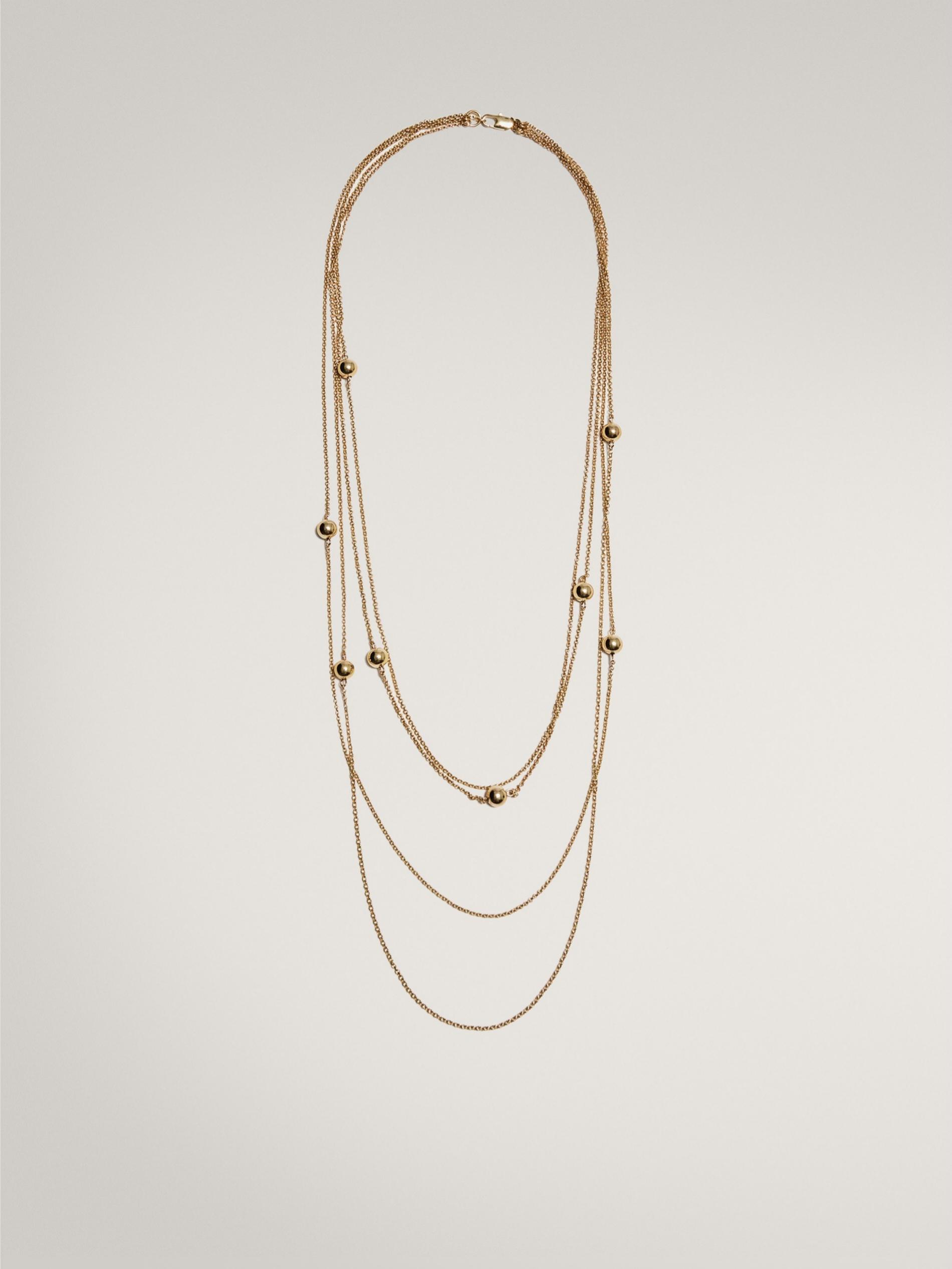Collar con varias cadenas y detalles de perlas de Massimo Dutti