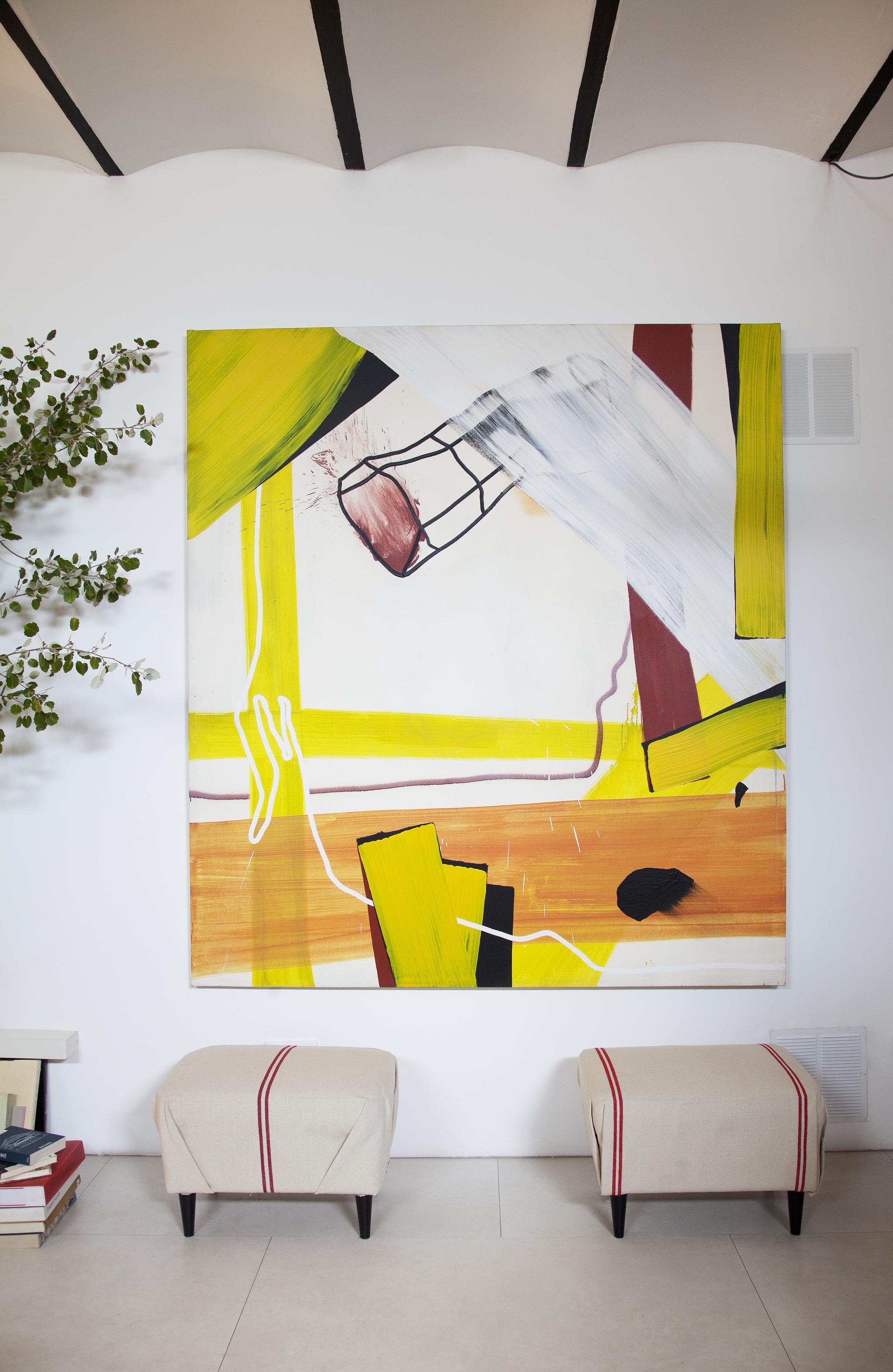 Taburetes de Ikea retapizados y cuadro de Juan Olivares.