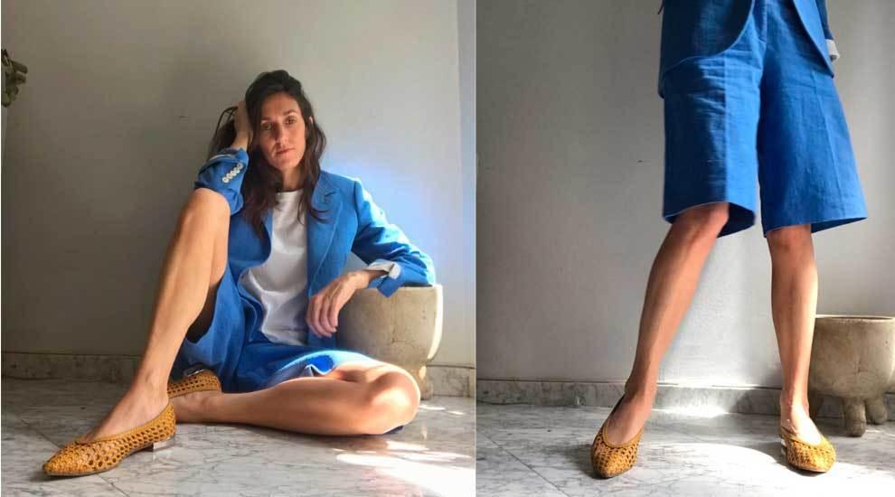 Cristina García Vivanco con el sastre bemuda en color azul.