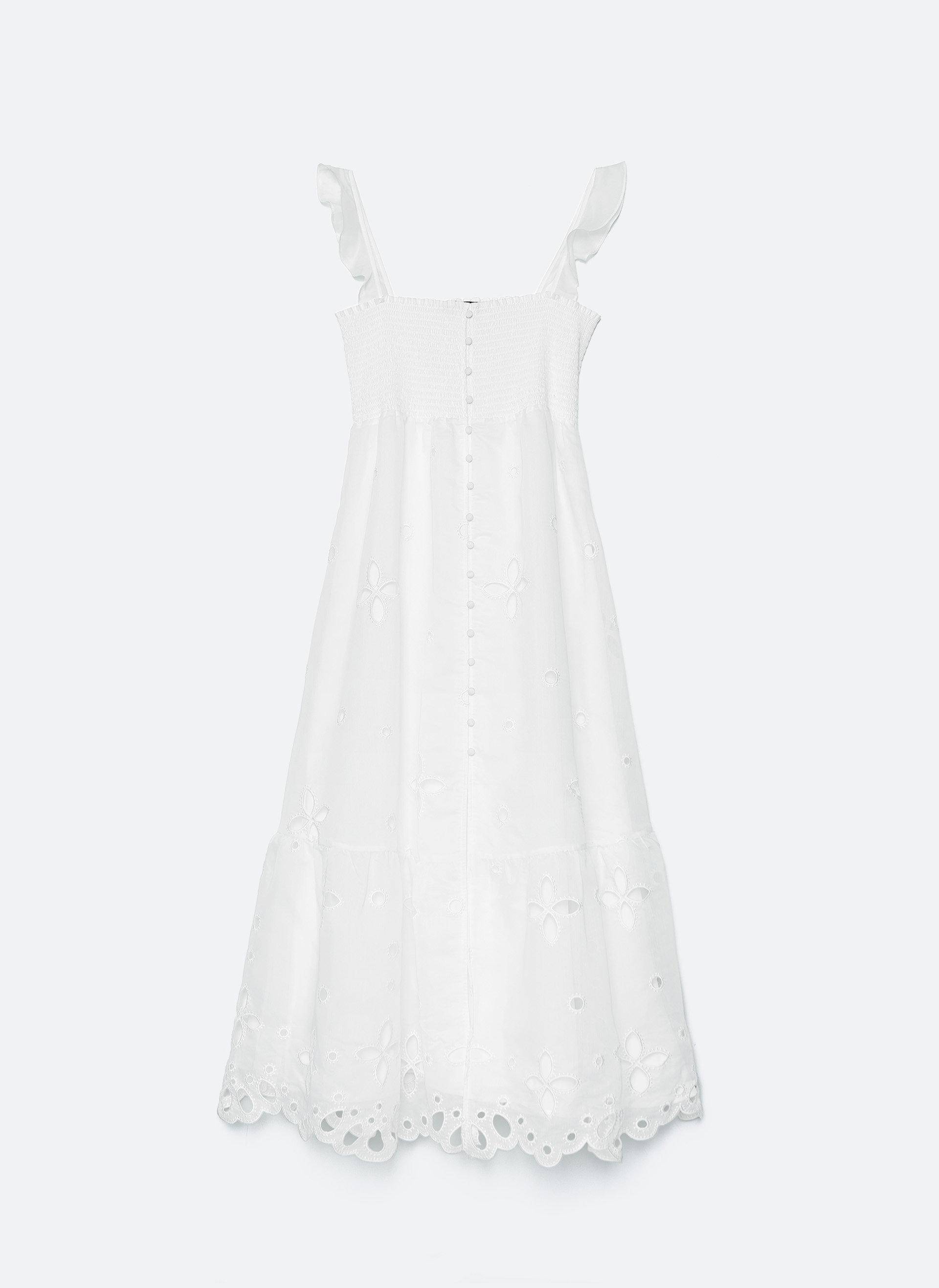 Este vestido romántico midi está elaborado en tejido de organza...