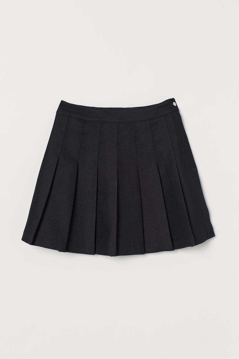 Falda plisada de HM (19,99 euros).