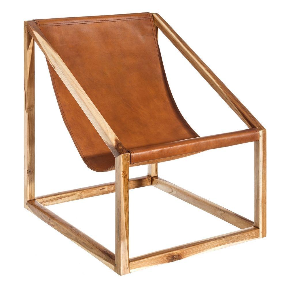 En Denzzo. Nos encanta este sillón de madera maziza de teka y cuero...