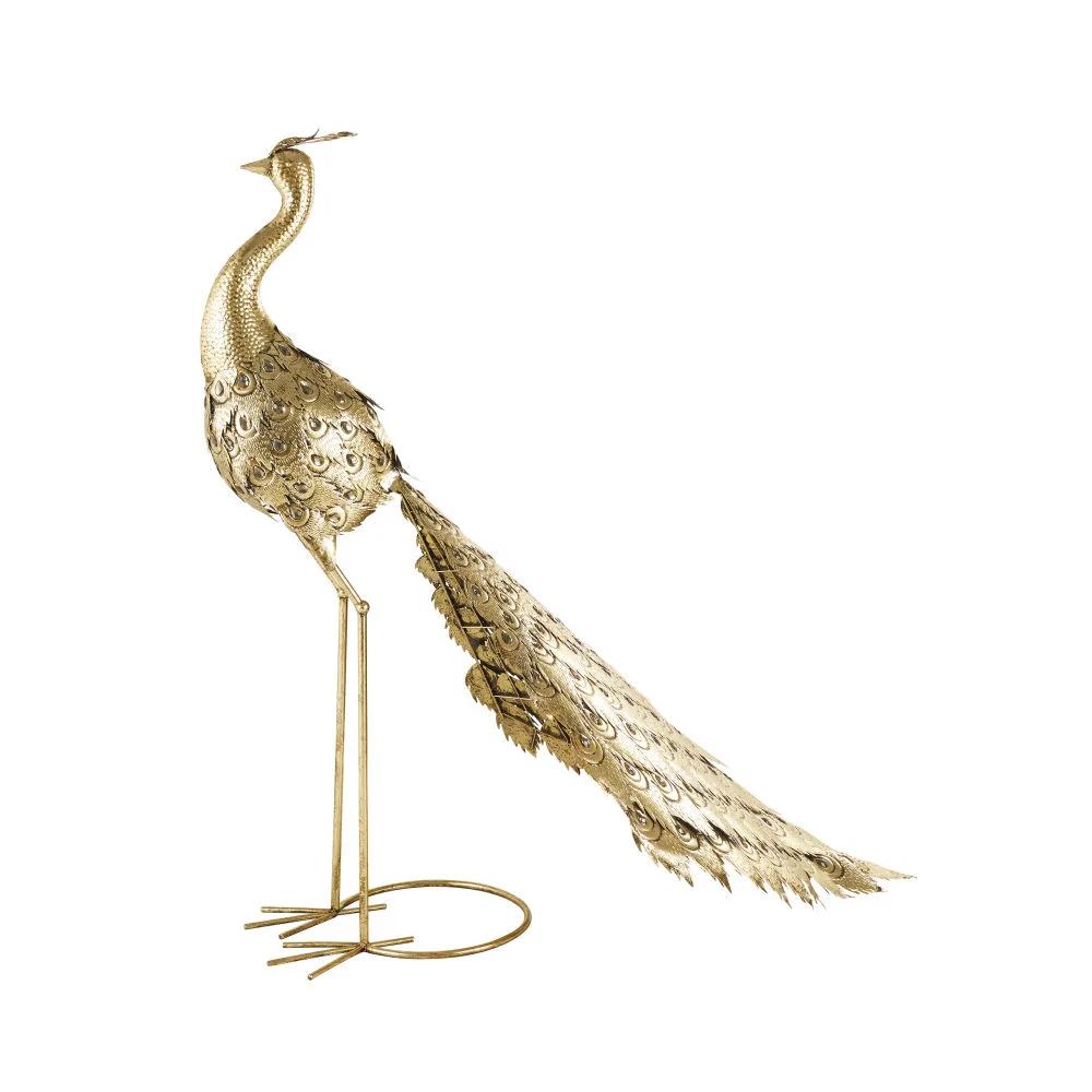 Estatua de pavo real de metal dorado con adornos ahumados. 299,90...