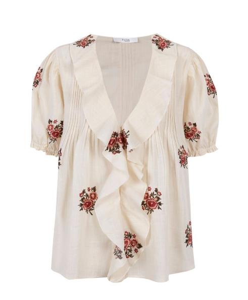 Blusa de algodón bordada (99 euros).