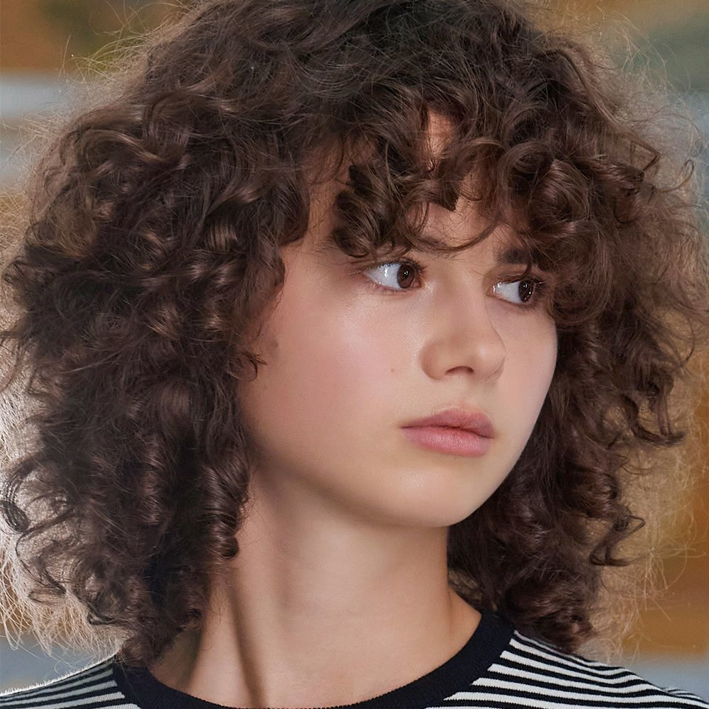 Los flequillos se llevarán en todas sus versiones y tanto Louis Vuitton como Hermès apuestan por sus versiones más curly para pelo rizado.