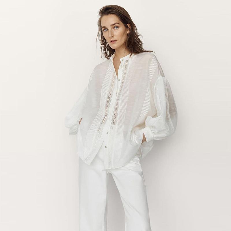 Camisa bordado de seda.