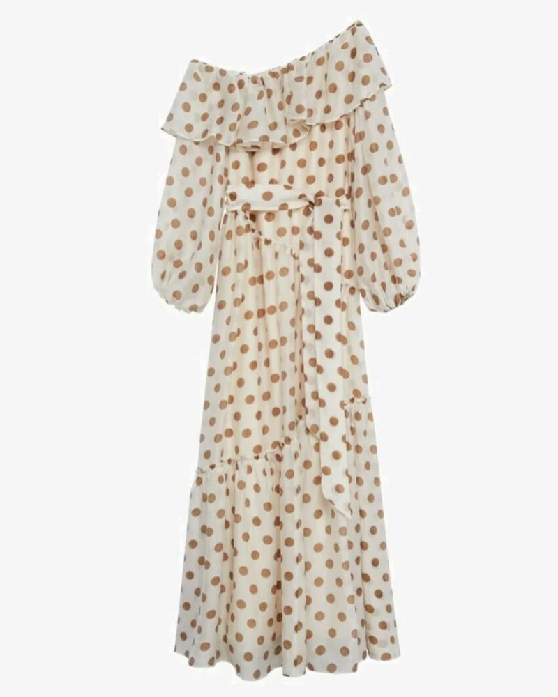 Vestido asimétrico con estampado de lunares de Mango.