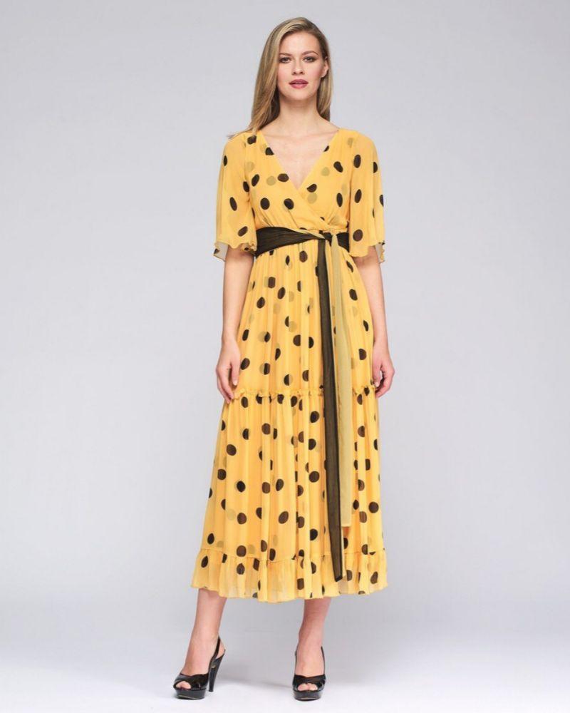 Vestido amarillo con estampado de lunares de Niza para El Corte Inglés.