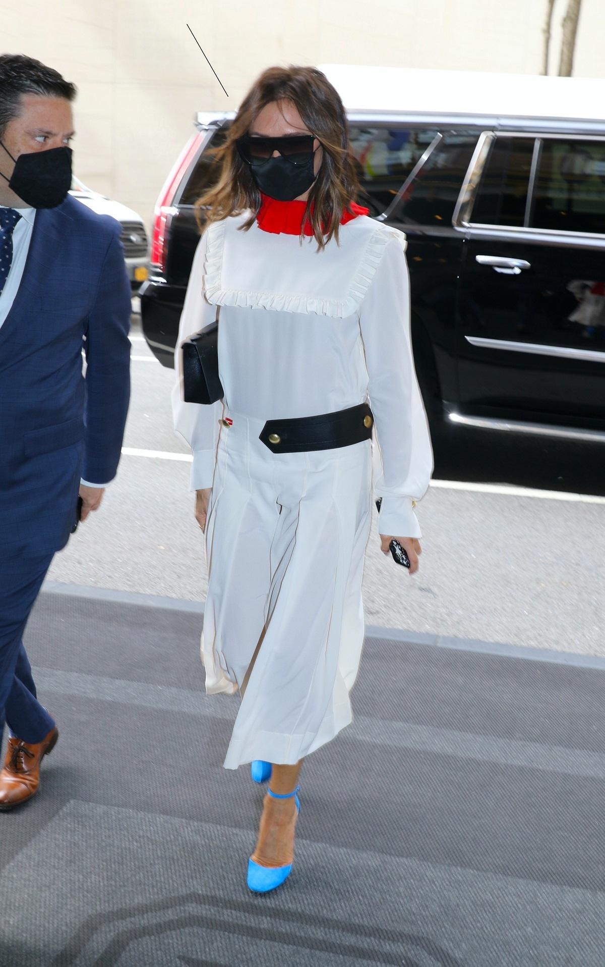 Victoria Beckham con el vestido infalible.