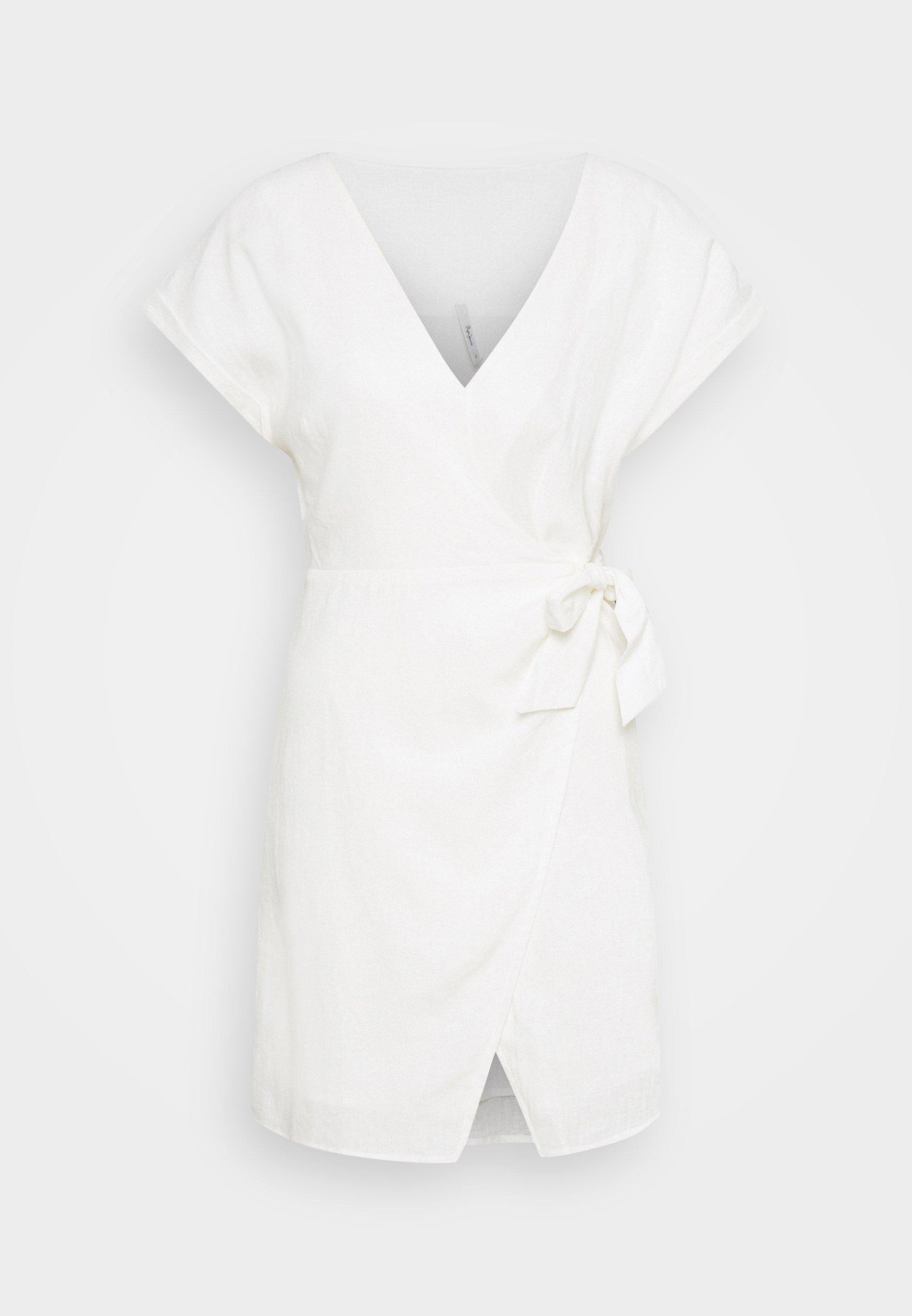 Vestido blanco corto con lazada y cuello en forma de V