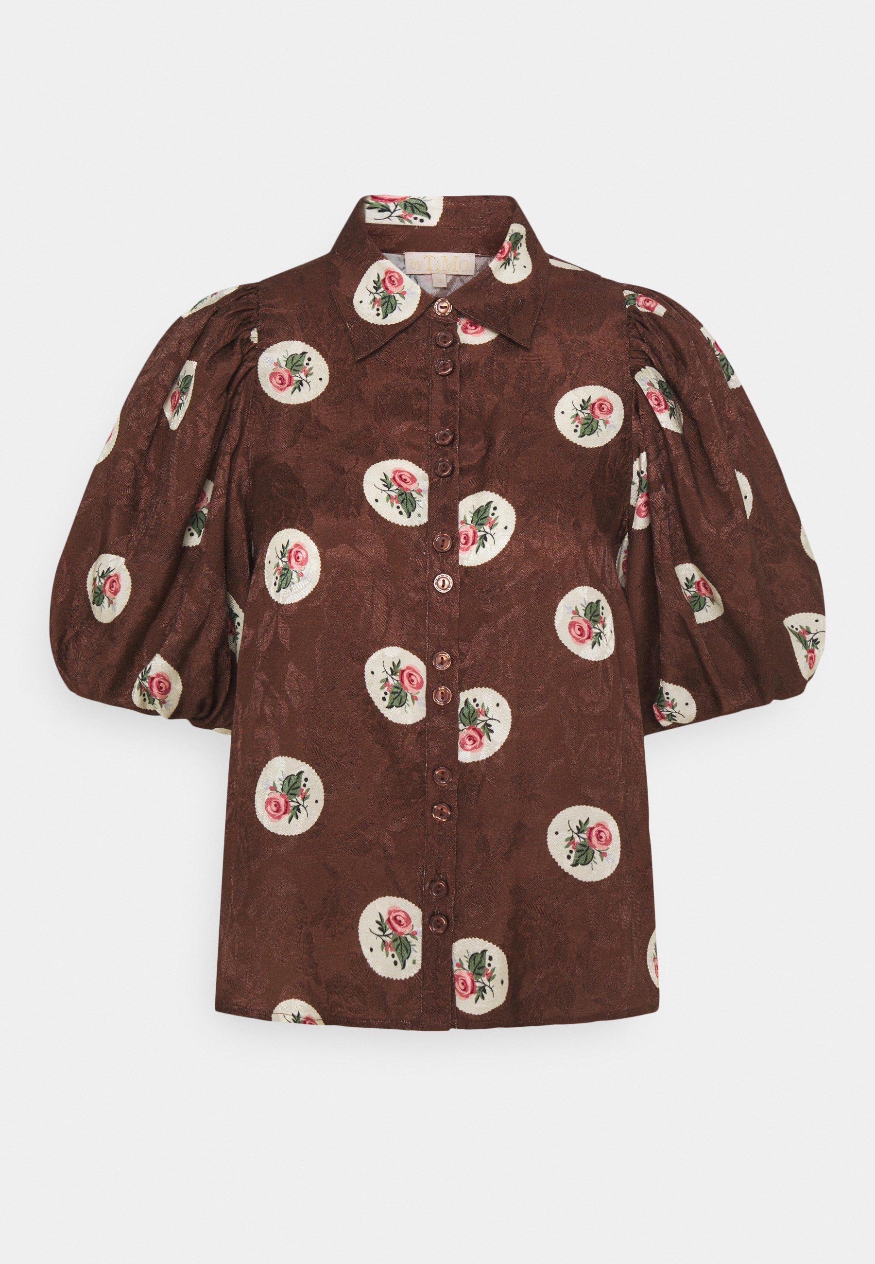 Camisa con mangas abullonadas de byTiMo