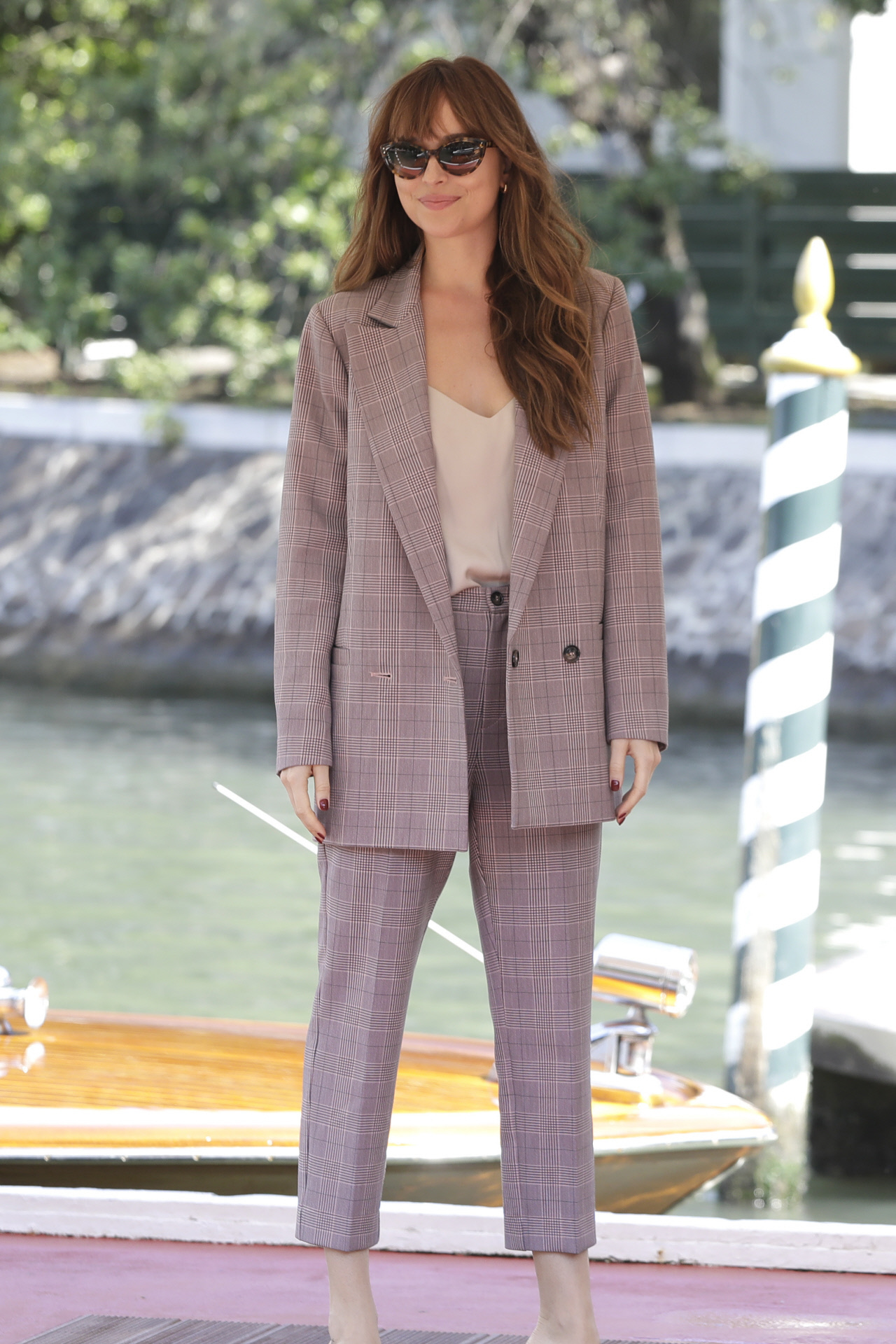Dakota Johnson in a tailored suit and matching top