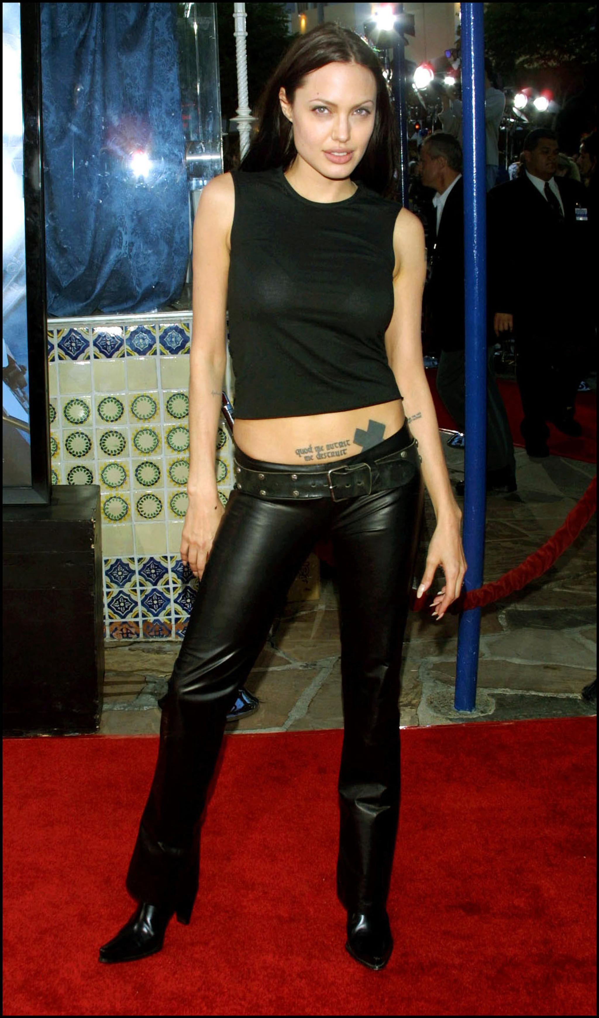 Los pantalones de cuero negro fueron uno de sus básicos en los 90