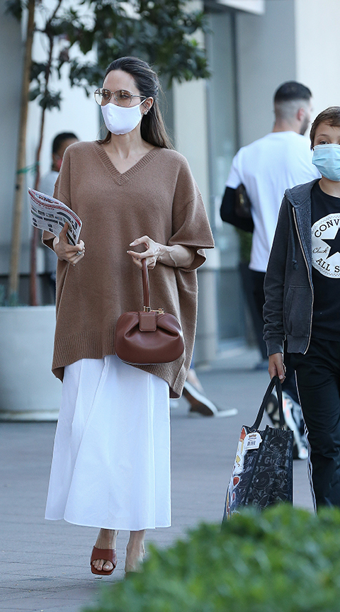 Angelina Jolie with a set in neutral tones.