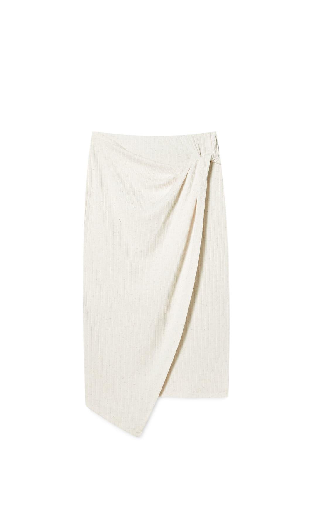 Falda blanca nudo lateral